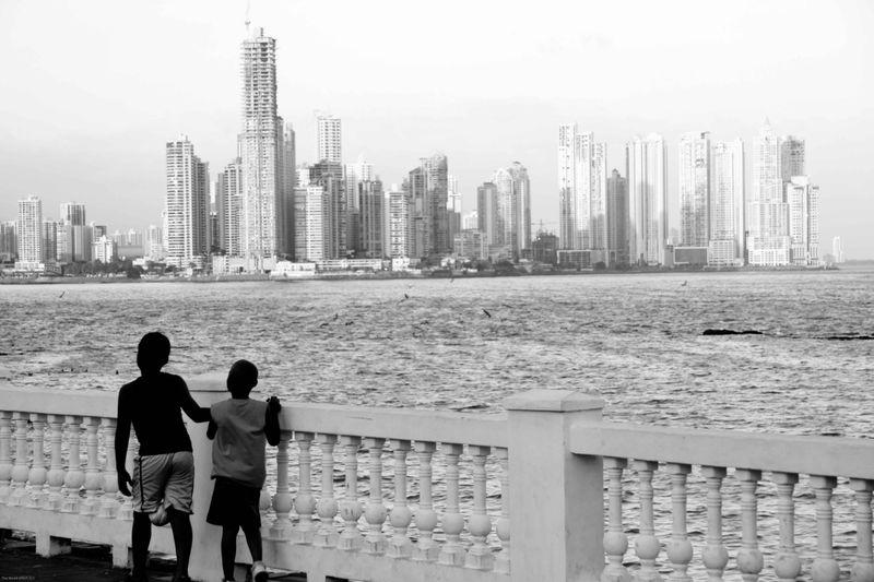local kids and the panama city skyline