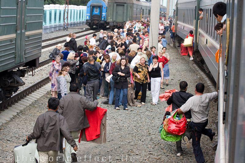 Mongolian Merchants hopping off the moving train