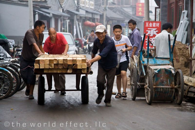 Beijing, China - moving wood in the back alleys